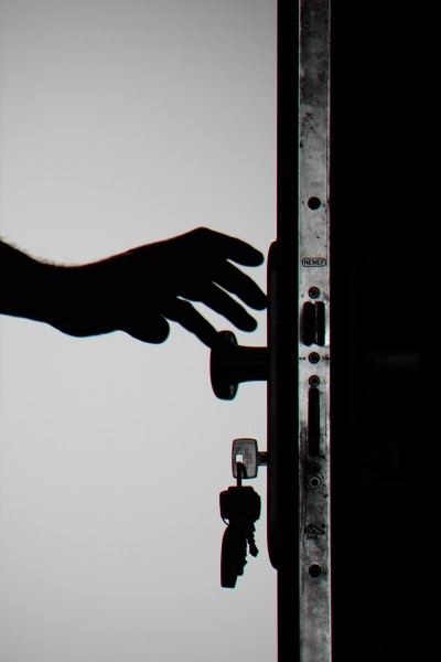 silhouette-photo-of-person-holding-door-knob-792032